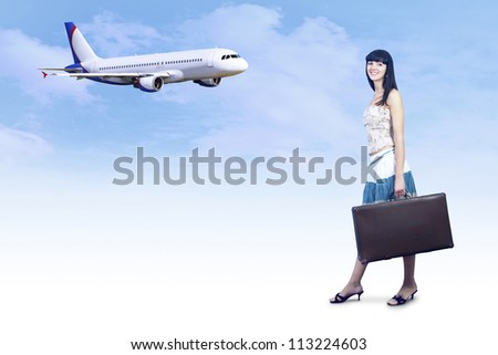 Young woman on the vintage baggage wait on the flying - stock photo