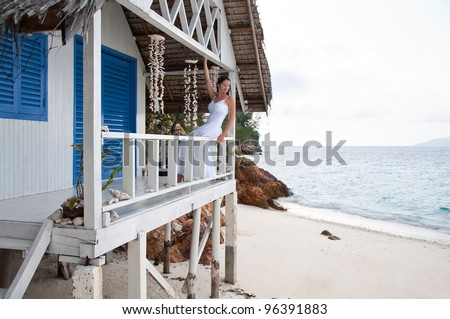Young woman  on tropical beach house - stock photo