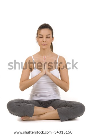 Young woman on white background in fitness pose. - stock photo