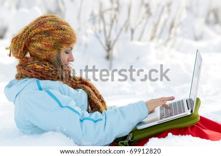 young woman outdoor using laptop - stock photo