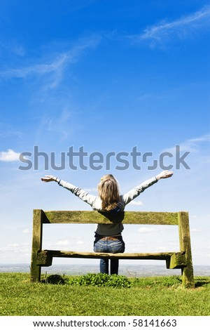 Young Woman Outdoors, Celebrating Or Worshipping God - stock photo