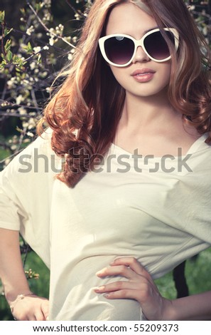 Young woman outdoors fashion portrait. - stock photo