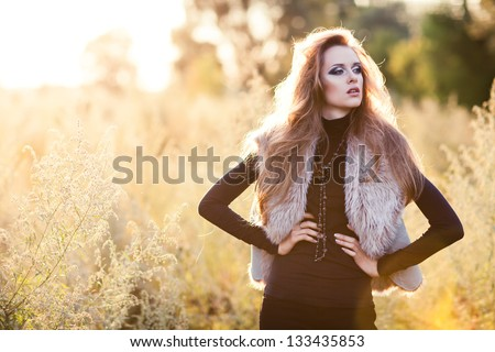 Young woman outdoors fashion portrait. Soft sunset light - stock photo