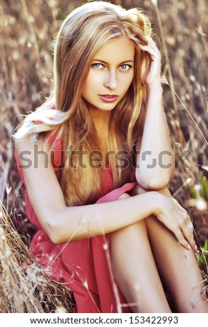 Young woman outdoors fashion portrait. Soft sunset light - stock photo