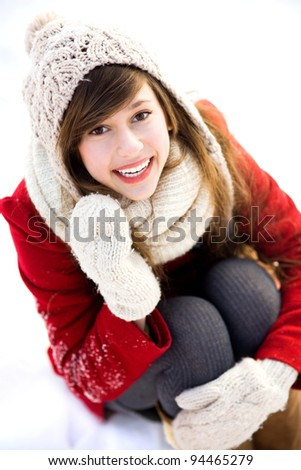 Young woman outdoors in winter - stock photo