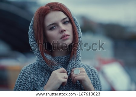 Young woman outdoors portrait. Soft colors. - stock photo