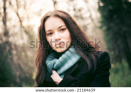 Young woman outdoors portrait. Soft red and blue tint. - stock photo
