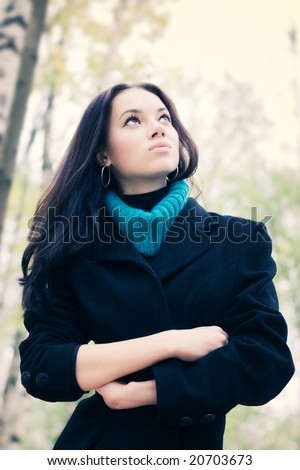 Young woman outdoors portrait. Soft yellow and blue tint. - stock photo