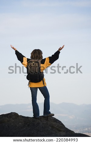 Young woman overlooking her surroundings - stock photo
