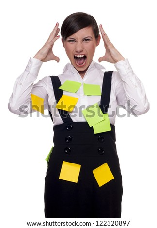 Young woman overwhelmed and stressed with too many tasks - stock photo