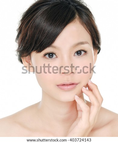 Young woman pampering her face by beauty slender fingers - stock photo