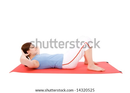 Young woman performing fitness exercises in the ground - stock photo