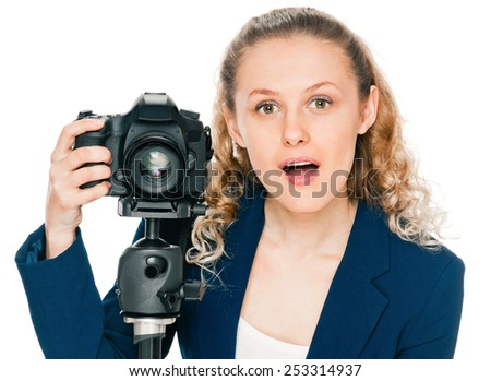 young woman photographer with camera on tripod - stock photo