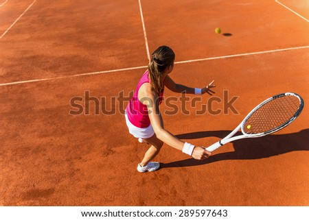 Young woman playing tennis.High angle view.Forehand . - stock photo