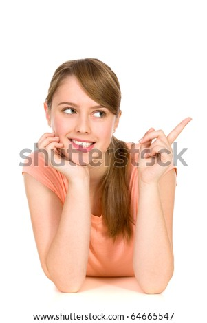 Young woman pointing - stock photo