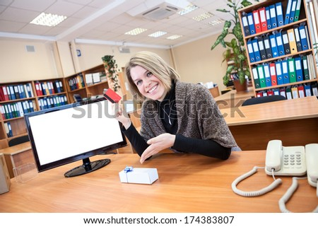 Young woman pointing at gift purchased over the Internet - stock photo