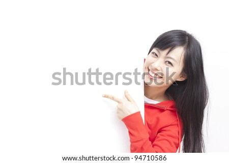 young woman pointing her finger at  blank board - stock photo