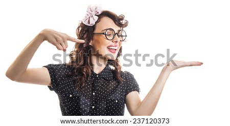 Young woman pointing with her finger something on hand, isolated on white. Profile of happy girl with copyspace  - stock photo