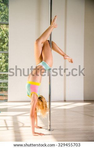 young woman pole dance  - stock photo