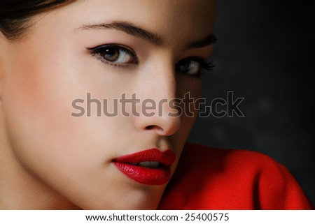 young woman portrait, dark background - stock photo