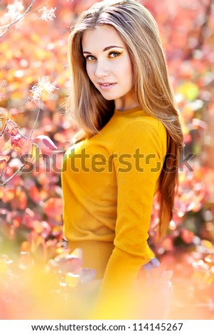 young woman portrait in autumn color - stock photo