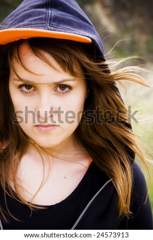 Young woman portrait in serious expression - stock photo