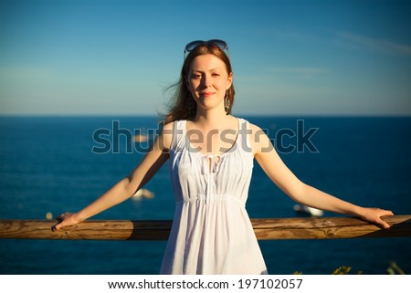 Young woman portrait on sea background. - stock photo