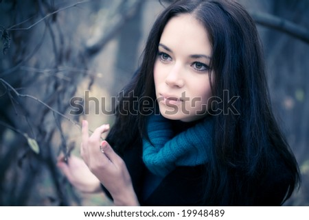 Young woman portrait. Soft yellow and blue tint. - stock photo
