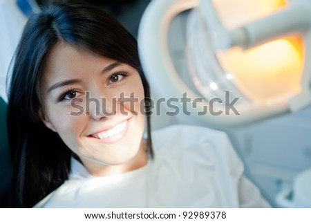 Young woman portrait visiting the dentist and smiling - stock photo