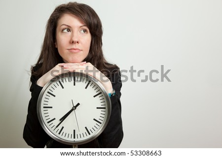Young woman posing by clock. Isolated on white - stock photo