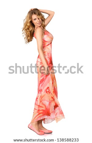 Young woman posing in long dress isolated on white background - stock photo