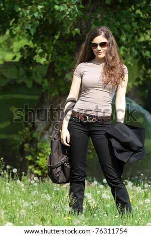 Young woman posing in the park - stock photo