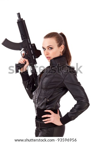 Young woman posing with a guns - stock photo