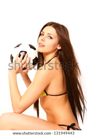 Young woman posing with a soccer ball on  white background - stock photo