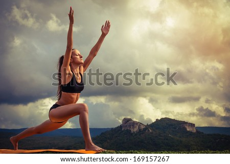 Young woman practiced surya namaskar yoga poses sequence - stock photo
