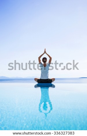 Young woman practicing yoga outdoors - stock photo