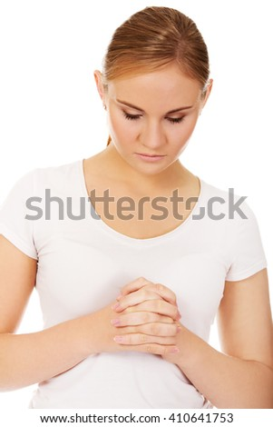 Young woman praying - religion concept - stock photo