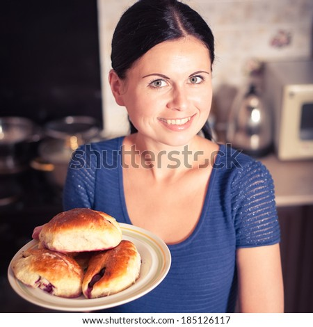 young woman prepared cherry pies, bon appetite. Photo in color style instagram filters  - stock photo