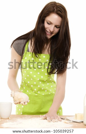 young woman preparing dough for baking on white background - stock photo