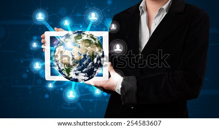 Young woman presenting 3d earth globe in modern tablet - elements of this image furnished by NASA - stock photo