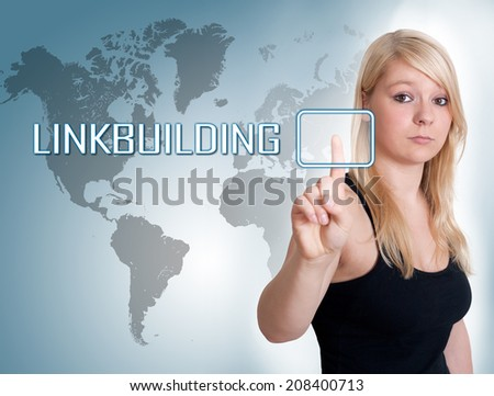 Young woman press digital Linkbuilding button on interface in front of her - stock photo