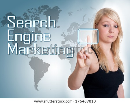Young woman press digital Search Engine Marketing button on interface in front of her - stock photo