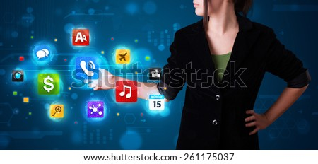 Young woman pressing various collection of high tech buttons - stock photo