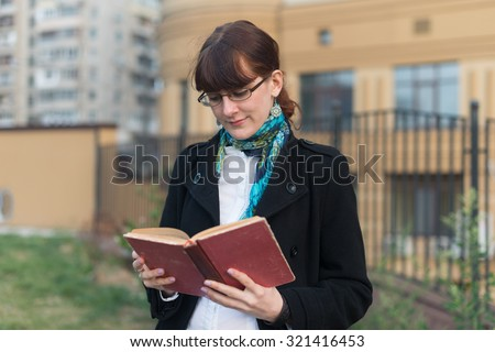 Young woman reading a book in City urban - stock photo
