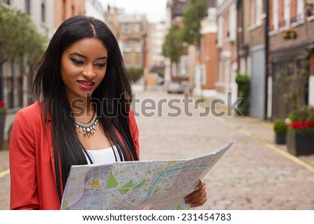 young woman reading a map - stock photo