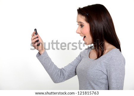 young woman receiving good news on her cell - stock photo