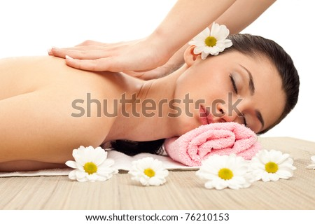 young woman receiving massage on back and neck - stock photo