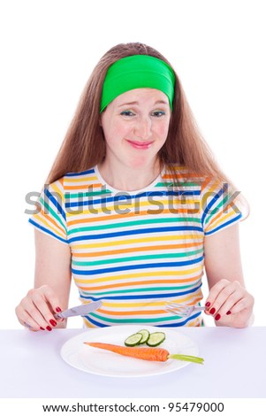 Young woman refuse to eat vegetables - stock photo