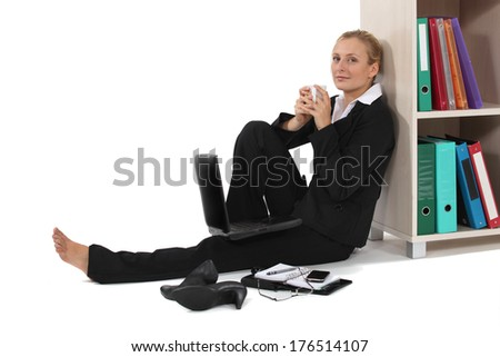 Young woman relaxed in front of computer - stock photo
