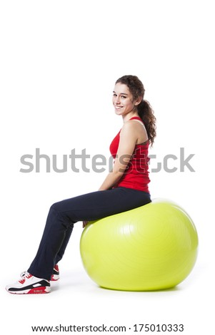 Young woman relaxing after workout exercise ball (isolated on white) - stock photo